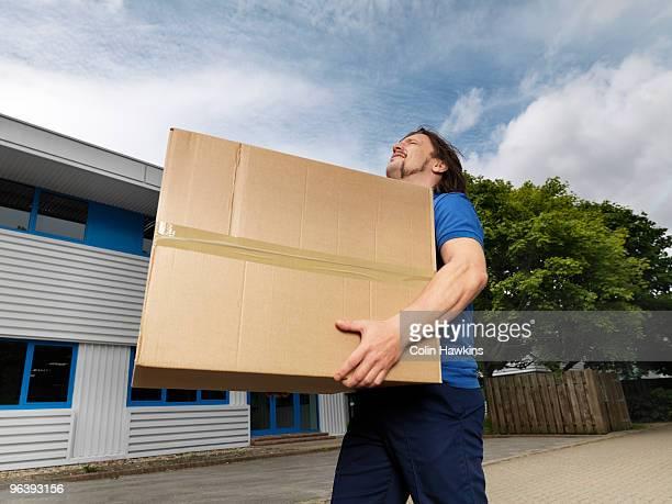 man carrying heavy box