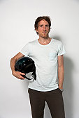 Man carrying helmet against white background