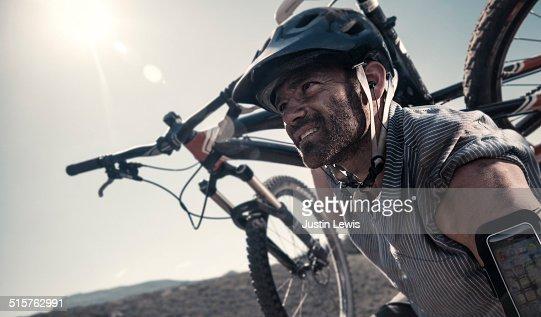 Man Carrying Mountain Bike, Gritty, Endurance