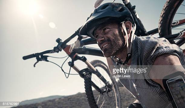 Man Carrying Mountain Bike, Gritty, Endurance