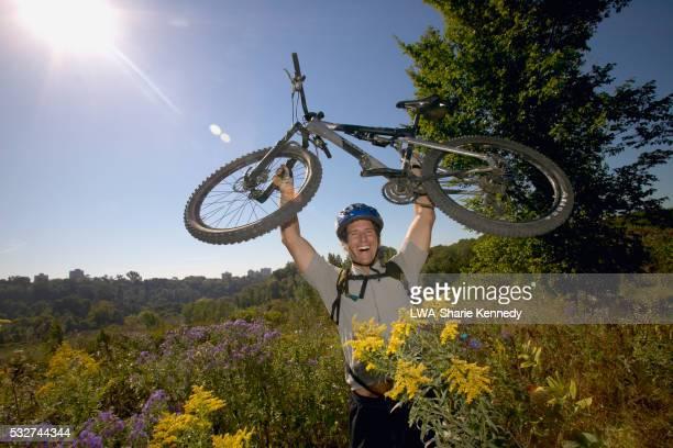 Man Carrying Mountain Bike