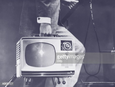 Man carrying portable television up steps, low section (B&W) : Stock Photo