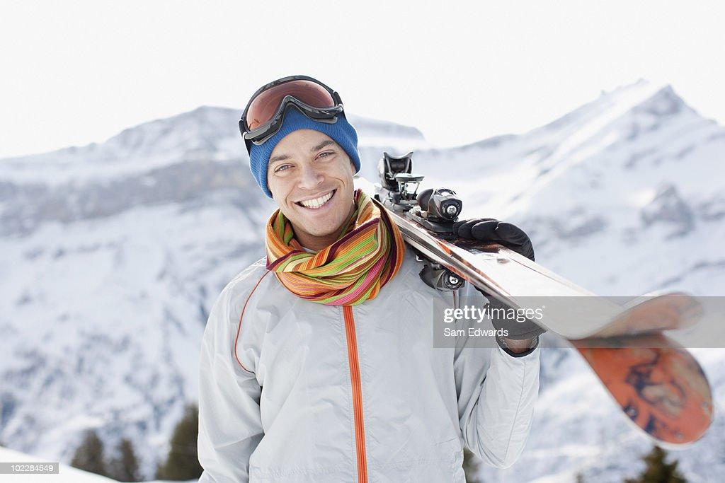 Man carrying skis : Stock Photo