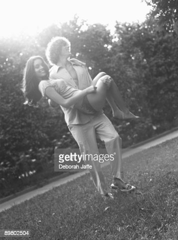 Man carrying woman outdoors : Stock Photo