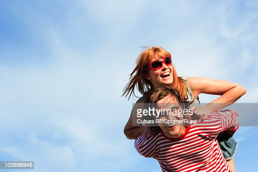Man carrying woman : Stock Photo