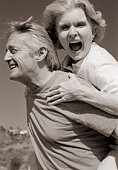 Man carrying woman piggyback