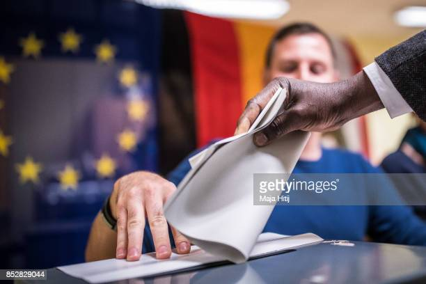 Man casts a ballot at a polling station during German federal elections on September 24 2017 in Berlin Germany German Chancellor and Christian...