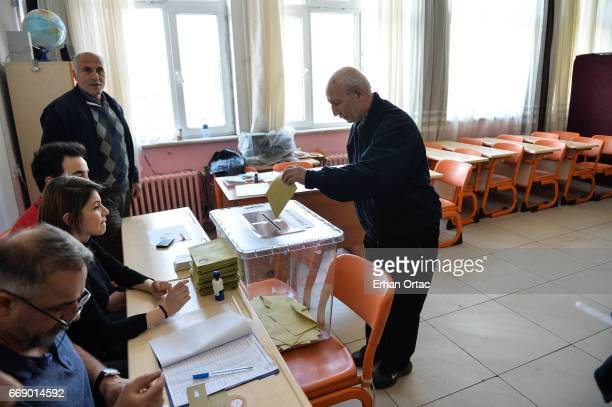 A man casts her ballot at a polling station during a referendum on April 16 2017 in Ankara Turkey Millions of Turks are heading to the polls to vote...