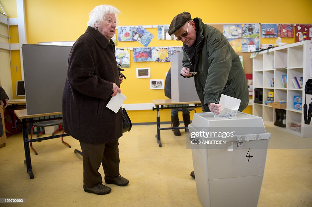 A man casts his ballot at a polling station at the Friedrich-Dierks Schule in Isernhagen on January 20, 2013 on polling day of the local elections in the central German state of Lower Saxony. The vote is largely seen as a test run for autumn's federal election.