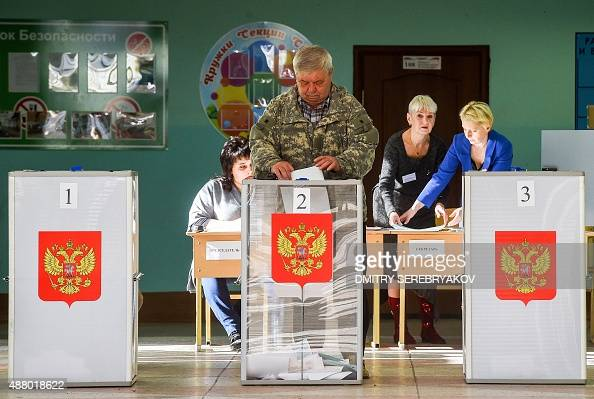A man casts his ballot for Russian regional elections at a polling station in the town of Kostroma some 300 km outside Moscow on September 13 2015...