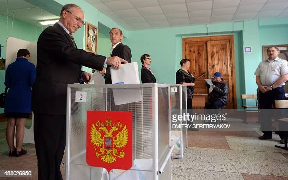 A man casts his ballot for the Russian regional elections at a polling station in the town of Kostroma some 300 km outside Moscow on September 13...