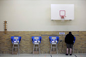 A man casts his ballot using an electronic voting machine November 6 2012 at an elementary school in Bowling Green Ohio Voting is underway in the US...