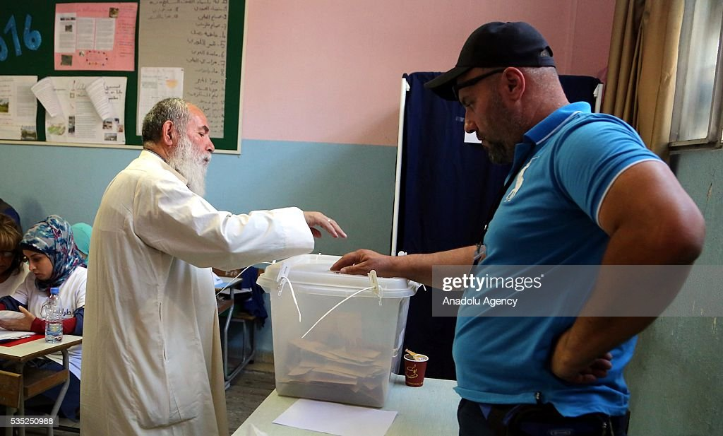 A man casts his vote at a polling station during the Lebanese Local elections in Tripoli, Lebanon on May 29, 2016.