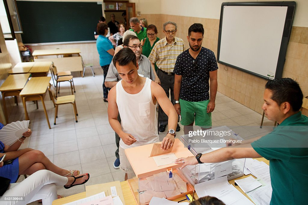 A man casts his vote at a polling station during the Spanish General Elections on June 26, 2016 in Madrid, Spain. Spanish voters head back to the polls after the last election in December failed to produce a government. Latest opinion polls suggest the Unidos Podemos left-wing alliance could make enough gains to come in second behind the ruling center right Popular Party.