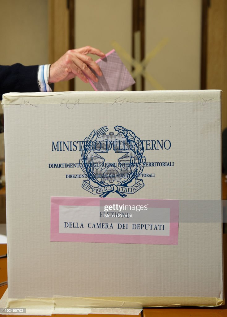 A man casts his vote at a Polling Station in Central Venice as the Italian General Election gets underway on February 24, 2013 in Venice, Italy. Italians are heading to the polls today to vote in the elections, as the country remains in the grip of economic problems . Pier Luigi Bersani's centre-left alliance is believed to be a few points ahead of the centre-right bloc led by ex-Prime Minister Silvio Berlusconi.