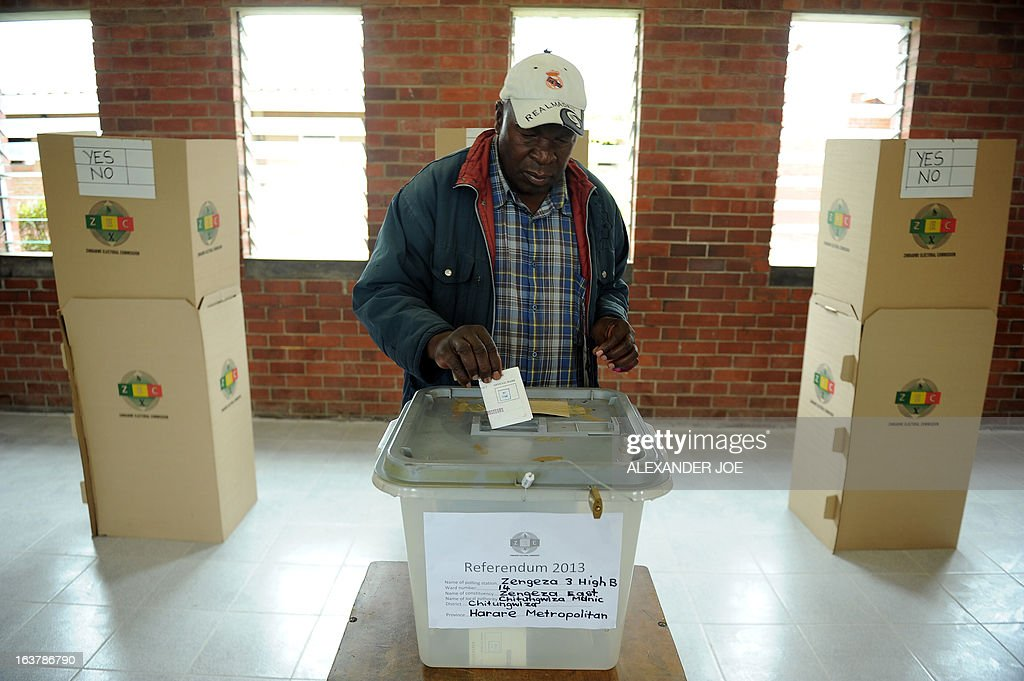 A man casts his vote at a polling station in Chitungwiza, on March 16, 2013, as voting kicked off for Zimbabwean referendum for a new constitution designed to underpin democratic reforms.