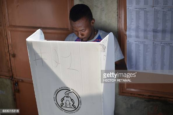 A man casts his vote at the canape vert market in the for Canape vert port au prince haiti