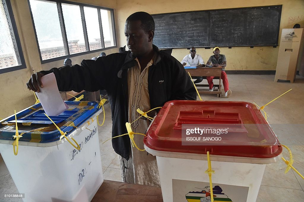 A man casts his vote at the polling station in the muslim district of PK 5 in Bangui for Central African Republic second round presidential and legislative elections on February 14, 2016. Voters in the Central African Republic began casting ballots on February 14 in delayed legislative elections and a presidential run-off which they hope will bring peace after the country's worst sectarian violence since independence in 1960.The nation, dogged by coups, violence and misrule since winning independence from France, could take a step towards rebirth if the polls go smoothly. SANOGO