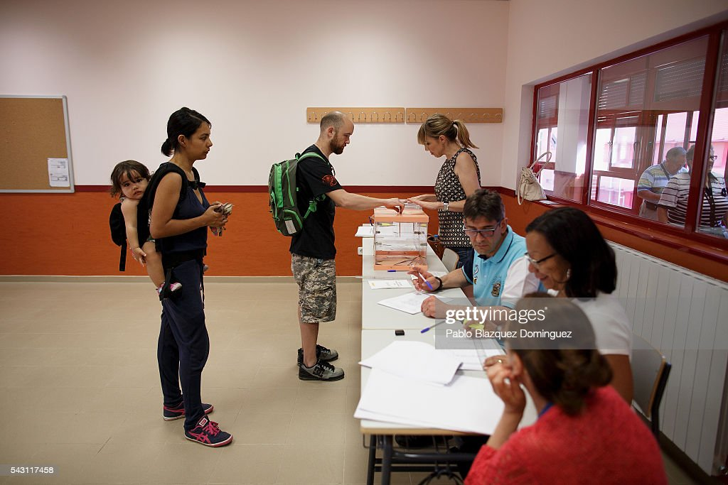 A man casts his vote during the Spanish General Elections on June 26, 2016 in Madrid, Spain. Spanish voters head back to the polls after the last election in December failed to produce a government. Latest opinion polls suggest the Unidos Podemos left-wing alliance could make enough gains to come in second behind the ruling center right Popular Party.