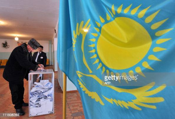 A man casts his vote in the presidential election in the village of of Malovodnoe some 70kms from Almaty on April 3 2011 Kazakhstan votes on April 3...