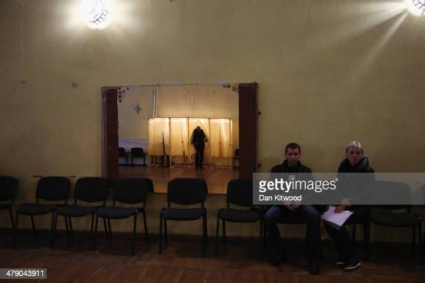 A man casts his vote inside a polling station in Simferopol on March 16 2014 in Simferopol Ukraine Crimeans go to the polls today in a vote that...