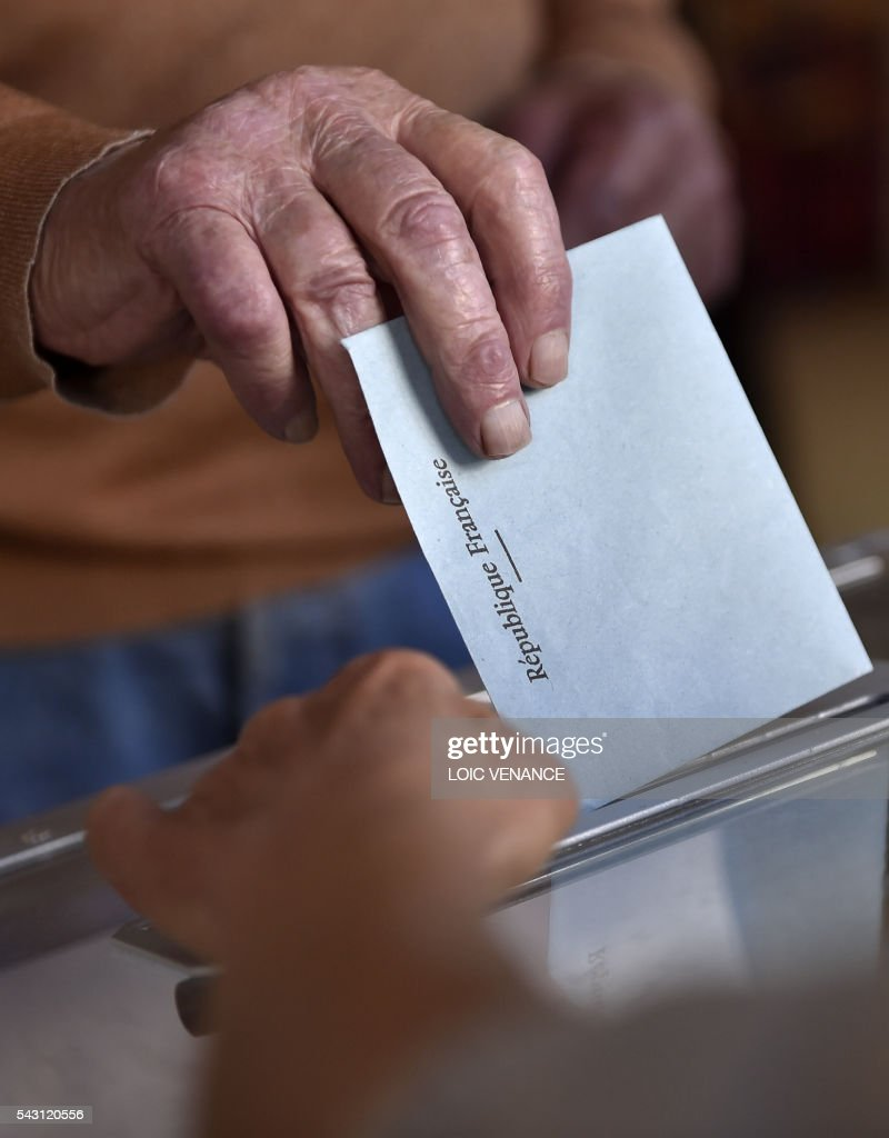 A man casts his vote on June 26, 2016 in Notre-Dame-des-Landes during a local referendum organised in Loire-Atlantique on subject of the Notre-Dame-des-Landes' airport project. Nearly One million people living in France's Loire-Atlantique department are voting in a referendum which poses the question 'Are you in favour of the project to transfer the Nantes-Atlantique airport to the municipality of de Notre-Dame-des-Landes?' to voters. The referendum was organised by the French executive power hoping to find a solution to the issue which has dragged on for 50 years. / AFP / LOIC