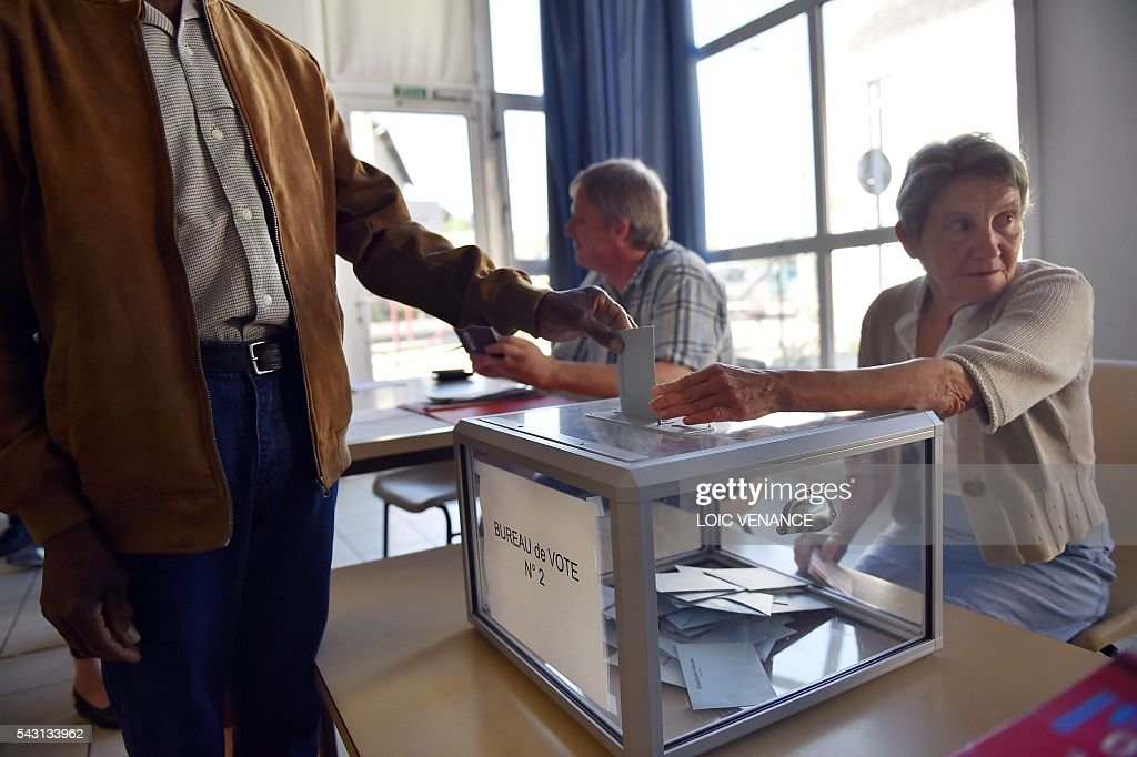 A man casts his vote on June 26, 2016, in Notre-Dame-des-Landes during a local referendum organized in Loire Atlantique regarding the transfer of the Nantes Atlantique airport to Notre-Dame-des-Landes. Nearly One million people living in France's Loire-Atlantique department are voting in a referendum which poses the question 'Are you in favour of the project to transfer the Nantes-Atlantique airport to the municipality of de Notre-Dame-des-Landes?' to voters. The referendum was organised by the French executive power hoping to find a solution to the issue which has dragged on for 50 years. / AFP / LOIC