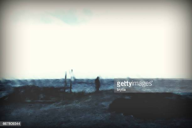 Man catching a breath of fresh air near the ocean