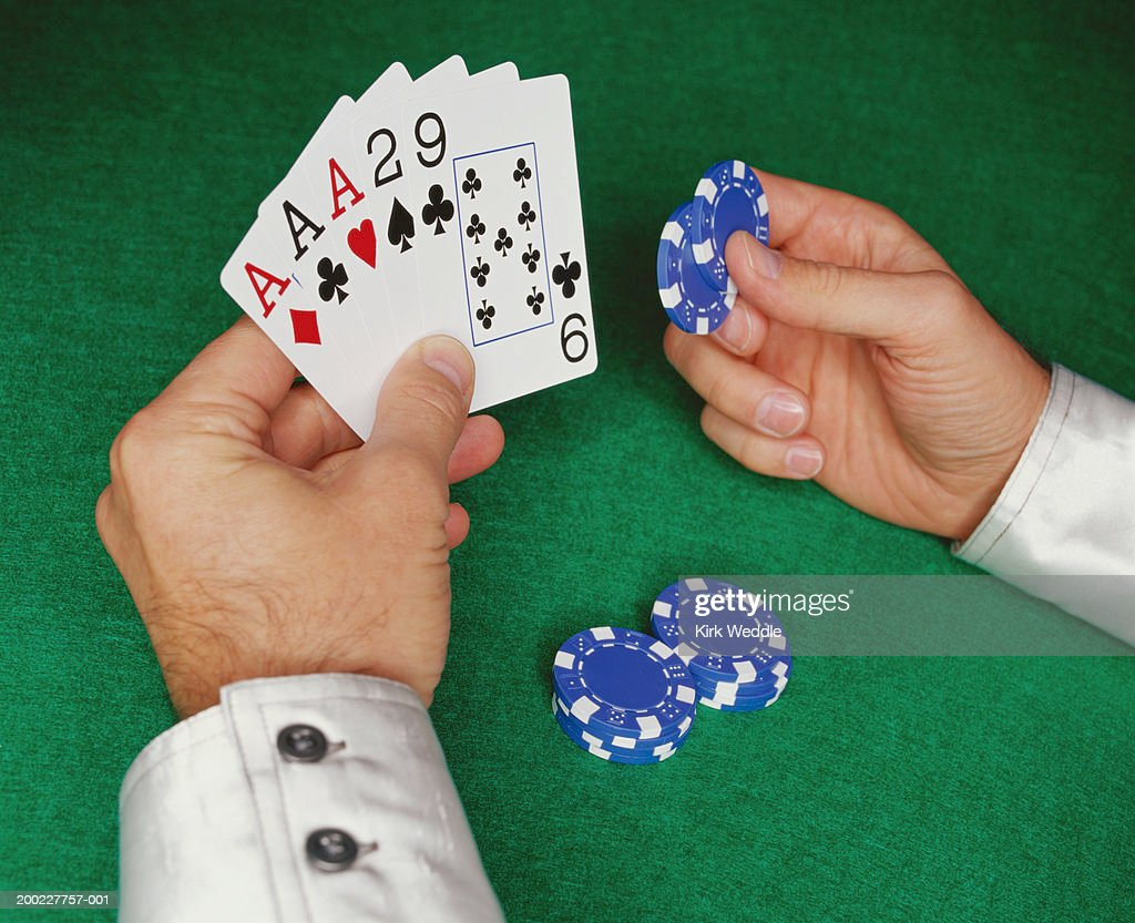 Man catching wad of crumpled paper, close-up of hand : Stock Photo