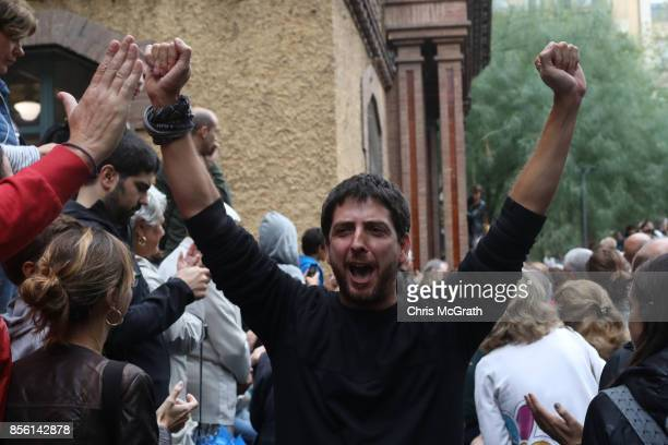 A man celebrates after casting his ballot voting in the referendum at Escola Industrial of Barcelona school polling station on October 1 2017 in...
