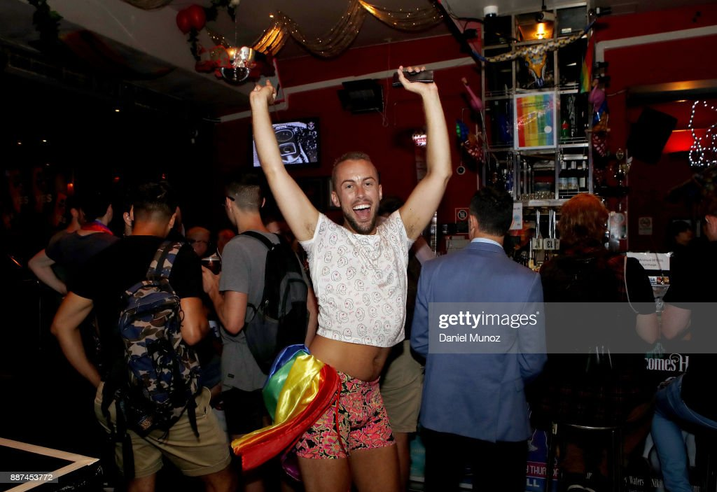 A man celebrates after the passing of the gay marriage bill on December 7, 2017 in Sydney, Australia. The historic bill was passed on the final day of parliamentart sitting for 2017. The legislation means same-sex couples will now be able to be legally married in Australia. Australians voted 'Yes' in the Marriage Law Postal Survey for the law to be changed in November.