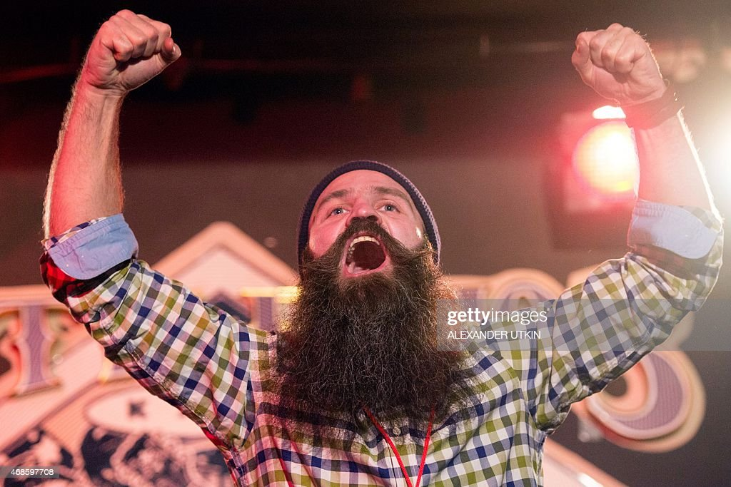 A man celebrates as he takes part in Russia's beard and mustaches championship in central Moscow on April 4, 2015.