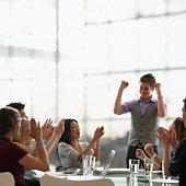 Man Celebrating During Business Meeting