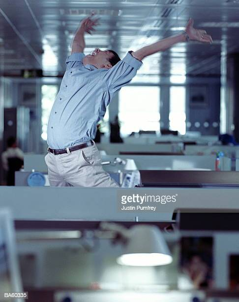 Man celebrating in office