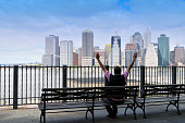 Man Celebrating Success in front of Manhattan Financial District,NYC