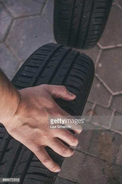 Man changes tires