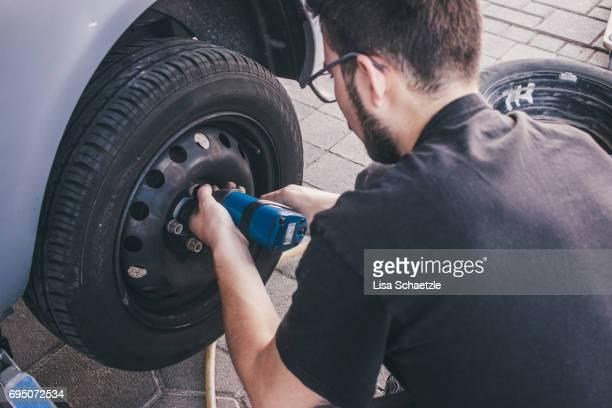 Man changes tires.