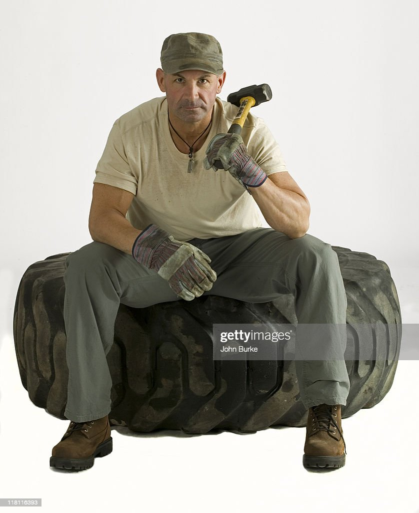Man changing huge truck tire : Stock Photo