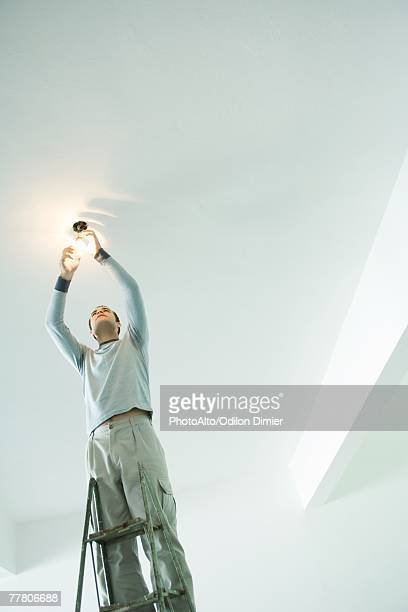 Man changing light bulb