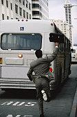 Man Chasing a Bus