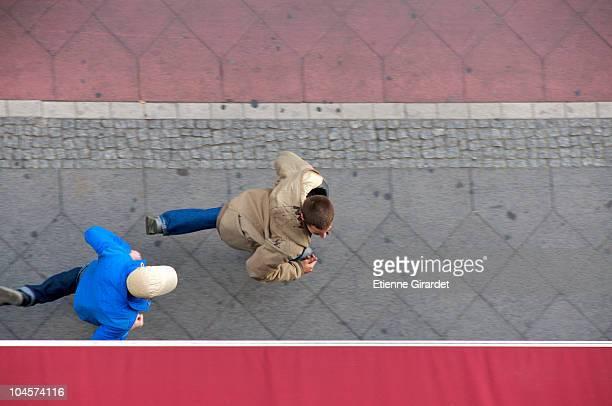 A man chasing his friend