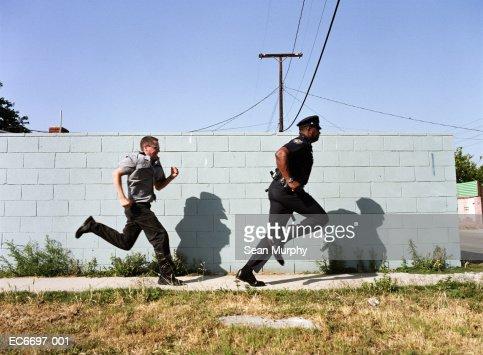 Man chasing police officer down sidewalk