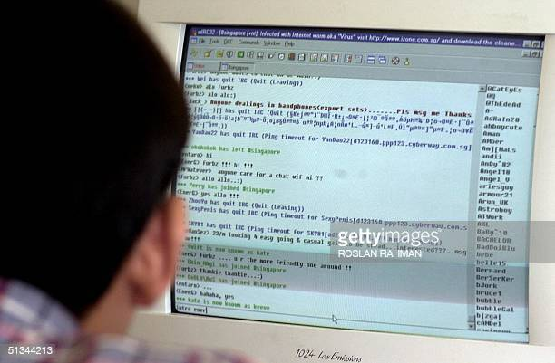 A man chats online using an Internet Relay Chat program logged onto an Internet chatroom in Singapore 07 August 2000 Singapore's Home Affairs...