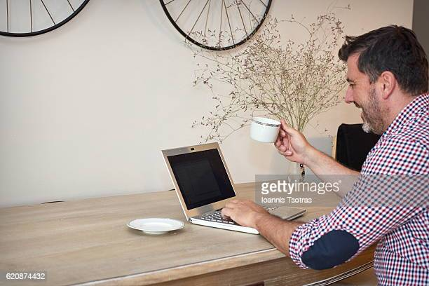 Man chatting on laptop and smiling