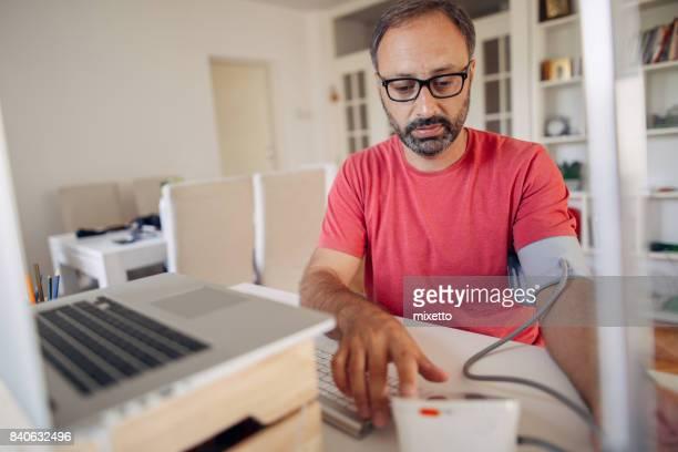 Man checking blood presure