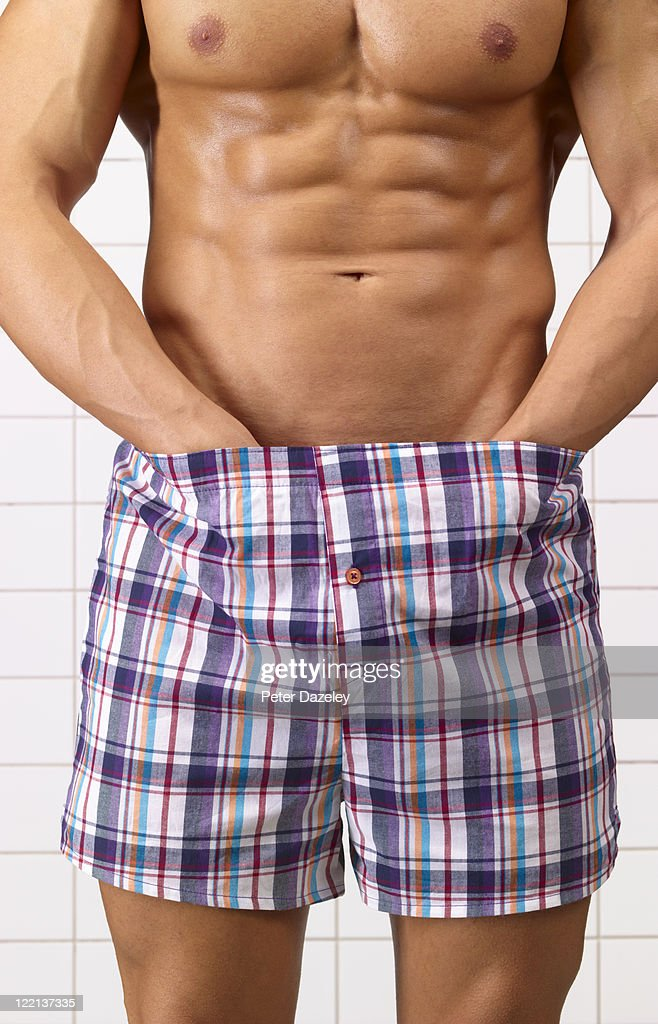 Man checking for testicular cancer : Stock Photo