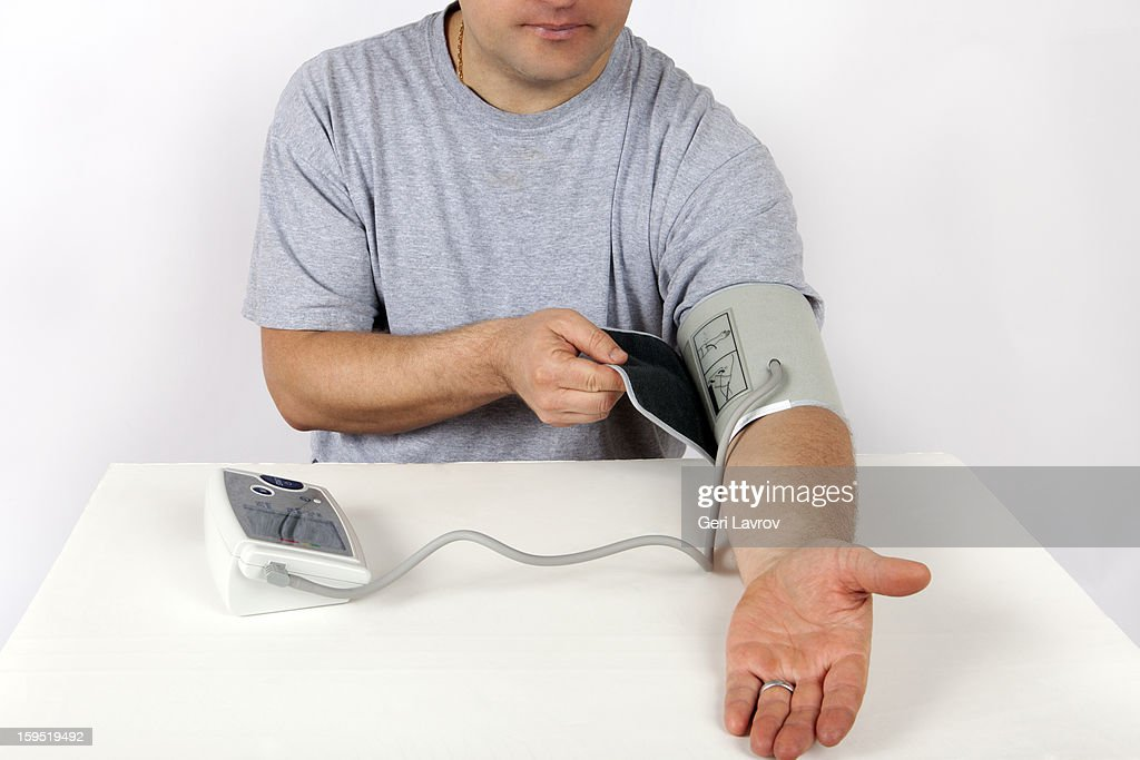 Man checking his blood pressure : Stock Photo