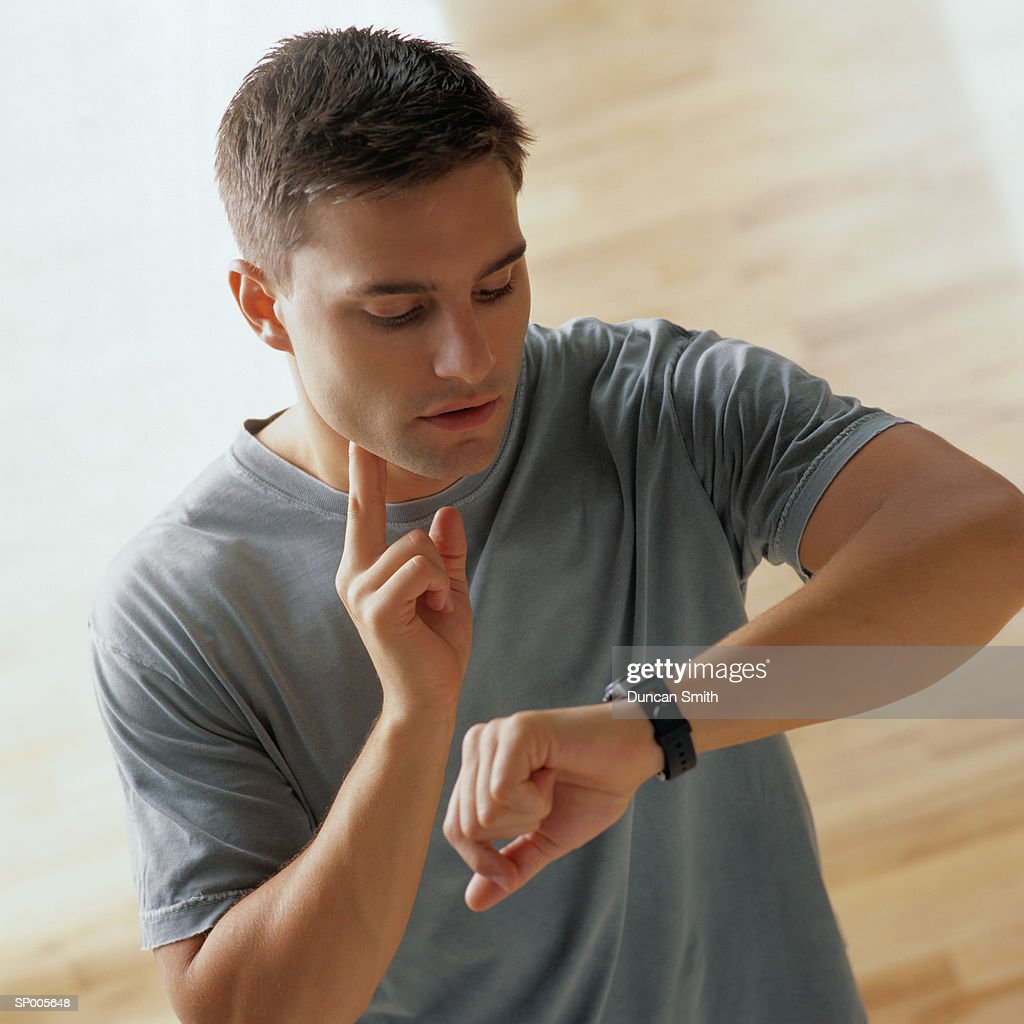 Man Checking his Pulse After Exercising