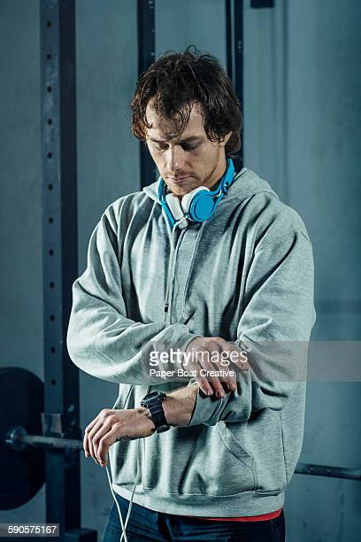 Man checking his stopwatch before workout