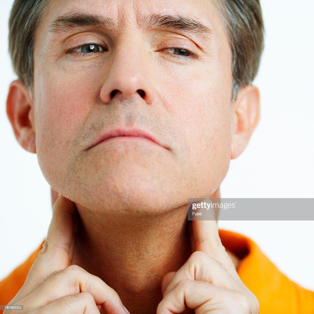Man Checking His Throat
